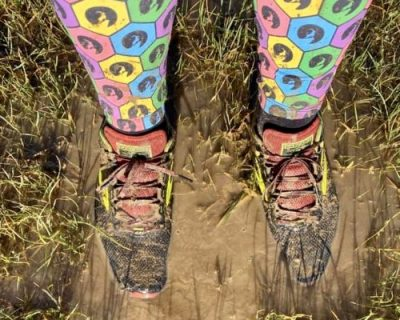Lonely Goat Virtual Runner standing in a muddy puddle