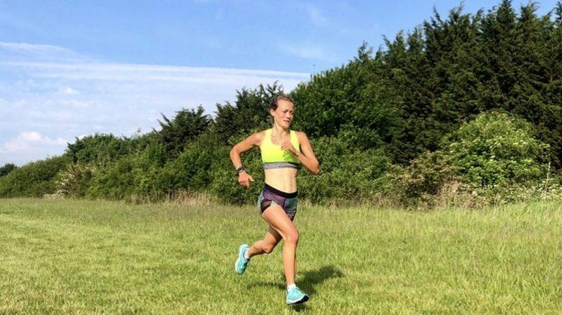 Hannah Irwin running in a field